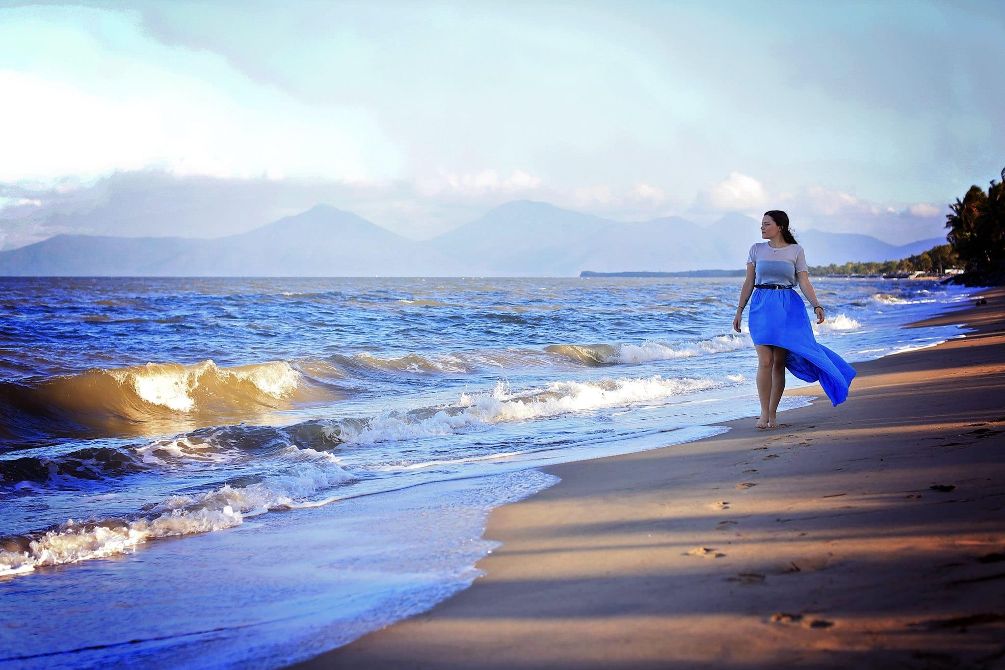 Rachel Wastell walking along a beach in Cairns